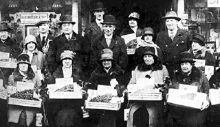 Old  black and white image of Royal British Legion Poppy Appeal collectors