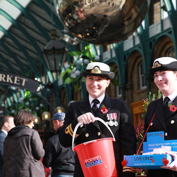 Royal British Legion Poppy Appeal collectors in a market