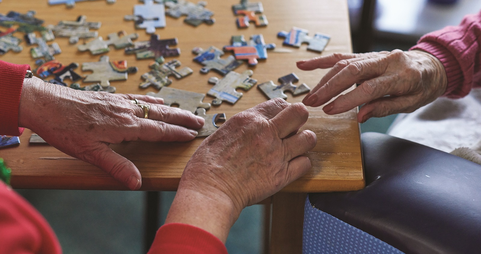 Residents completing a jigsaw at a Royal British Legion care home