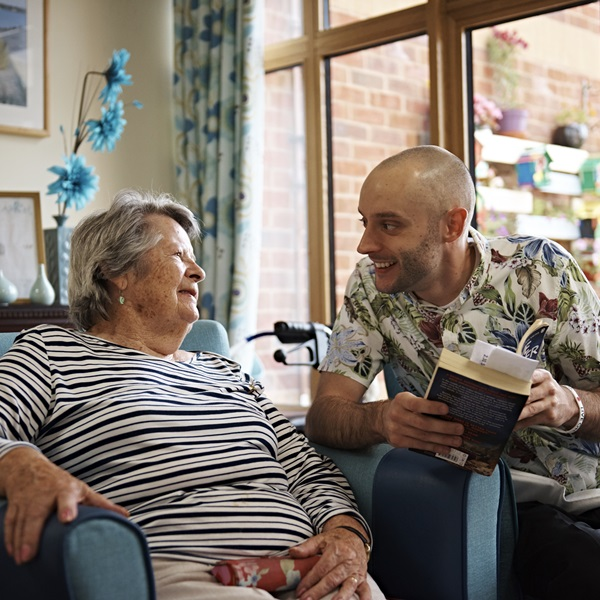 A resident with a care assistant at a Royal British Legion care home