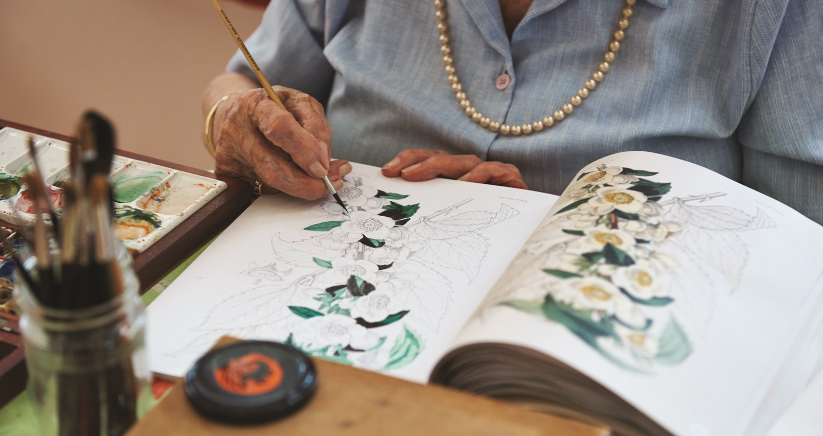 A resident painting at a Royal British Legion care home