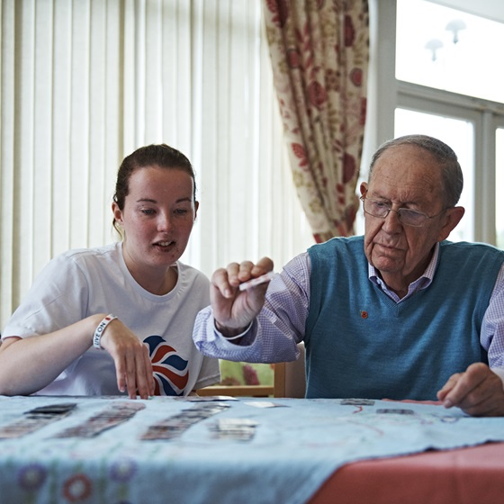 A resident with support worker at a Royal British Legion care home