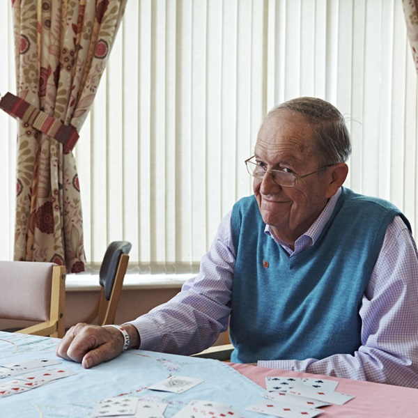 A resident playing cards at a Royal British Legion care home