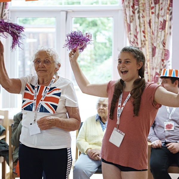 A volunteer with a veteran at a Royal British Legion care home