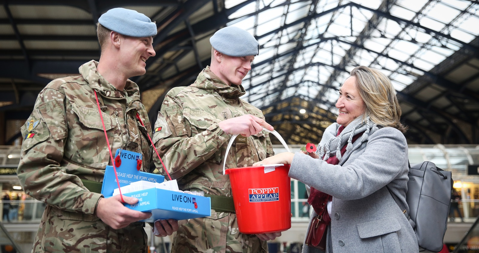 A member of the public giving a donation to the Poppy Appeal