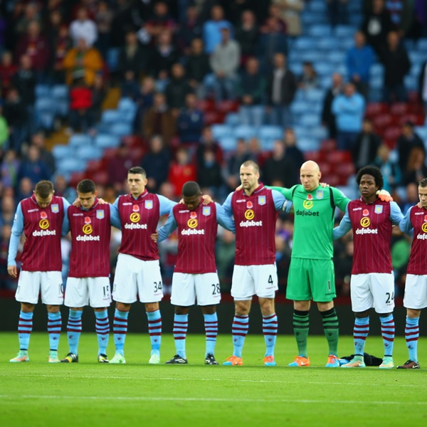 The 'Last Post' is played as players mark Remembrance Day at Aston Villa Park
