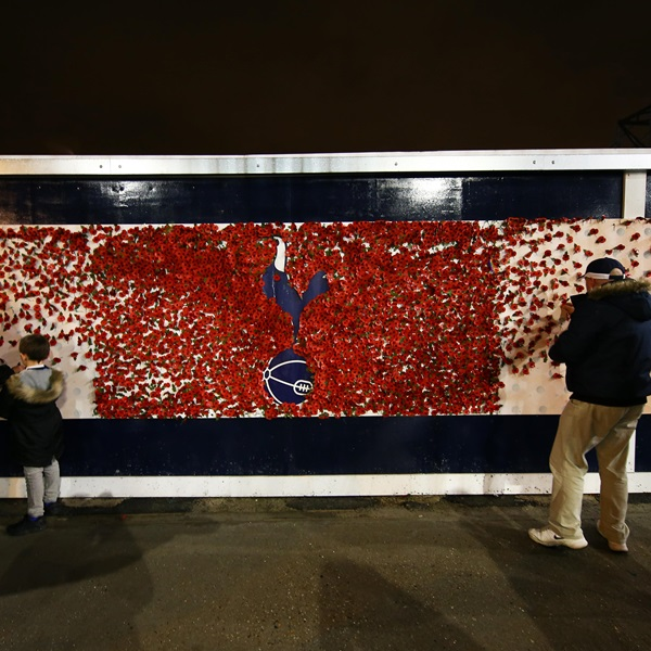 Tottemham Hotspurs fans pin Poppies to the Remembrance Wall at White Hart Lane