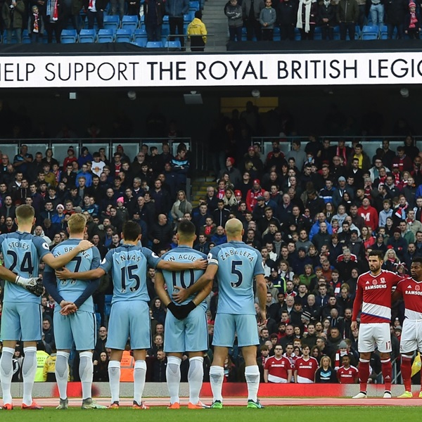 Manchester City players pause together in aid of The Royal British Legions poppy appeal at the Eithad stadium