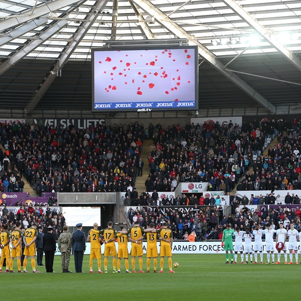 Brighton and Swansea players line up for a minute's silence ahead of Remembrance Sunday at  Liberty Stadium
