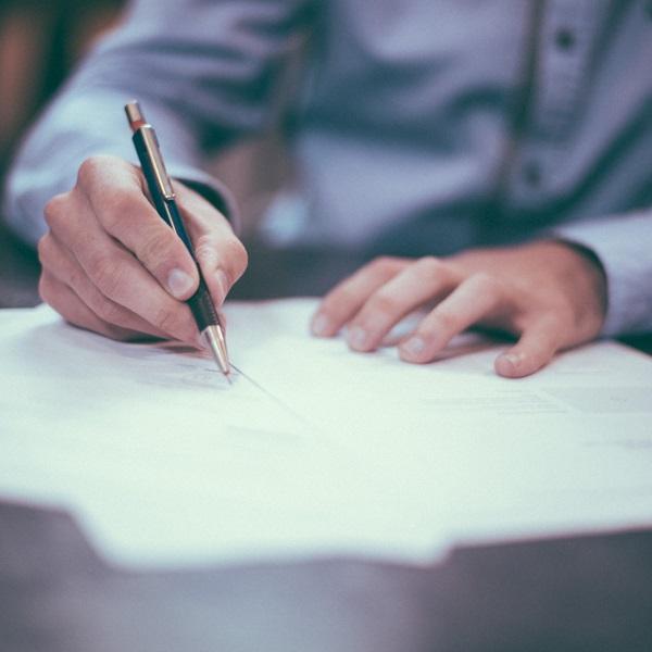 Man filling in procurement documents