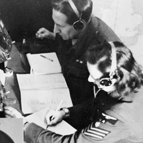 Operator speaking into the 'ghost voice' microphone at CORONA operating position at the Headquarters of the RAF 'Y' Service