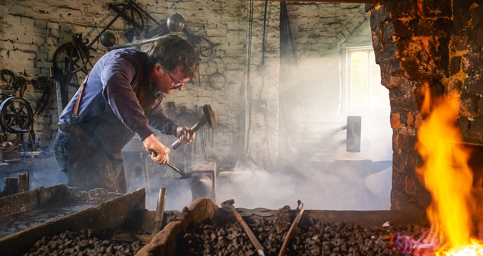 Man working as a blacksmith