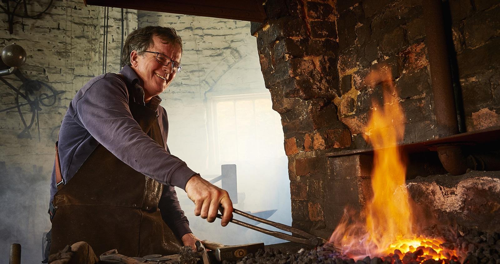 Veteran Tim Mackereth working as a blacksmith