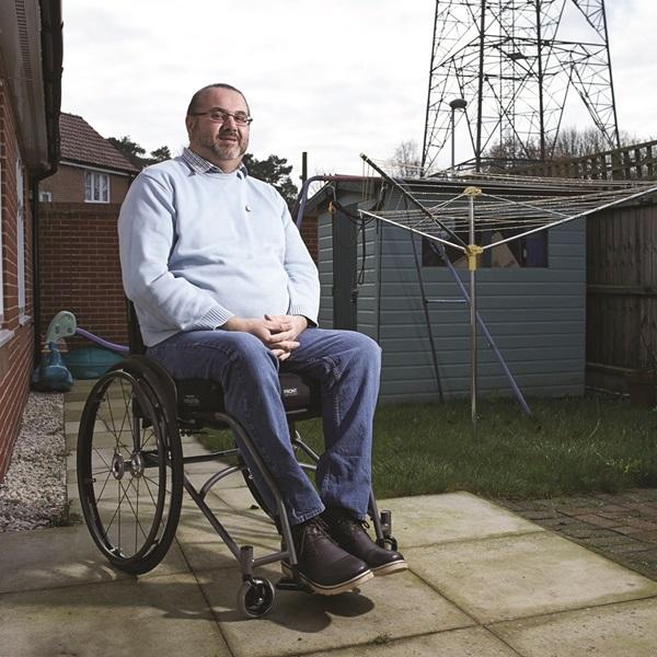 Man sitting in garden in a wheelchair