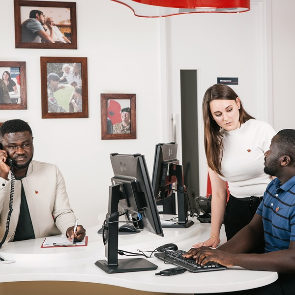 Three people working in a office