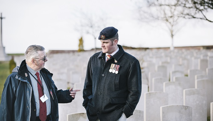 Veteran Liam Young  standing at a graveyard on a trip to the battlefields of the First World War