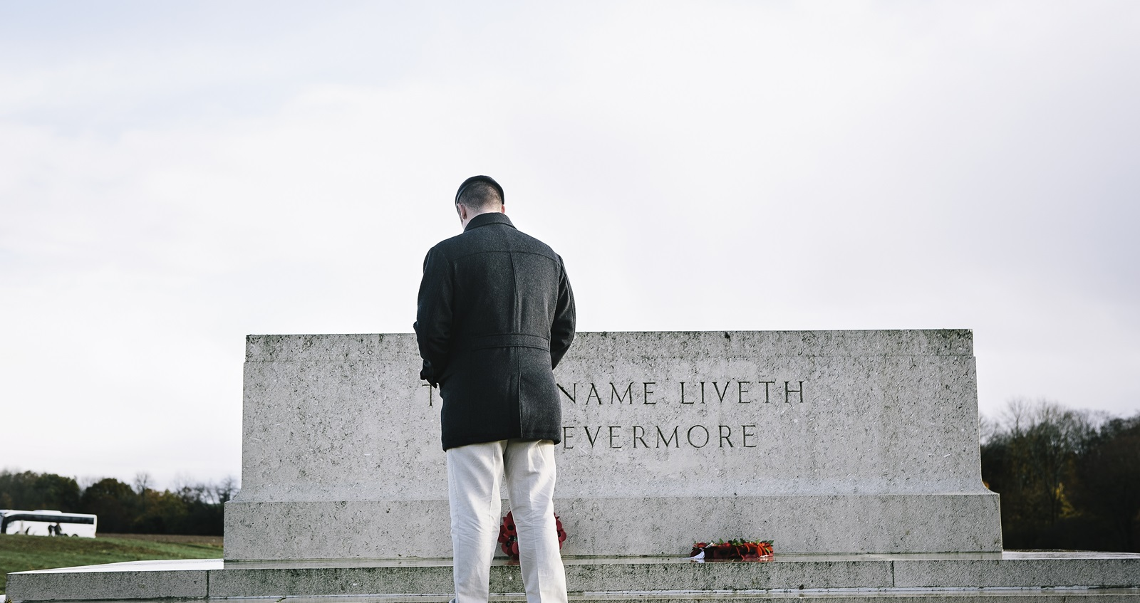 Veteran Liam Young bows his head before a memorial on a trip to the battlefields of the First World War