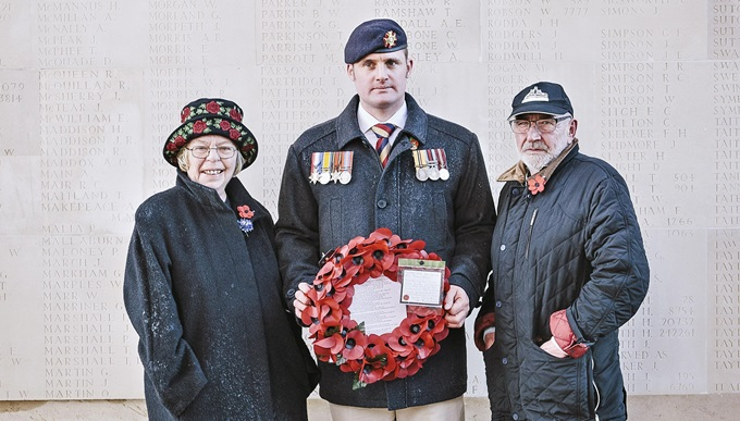Veteran Liam Young holding a poppy wreath on a trip to the battlefields of the First World War