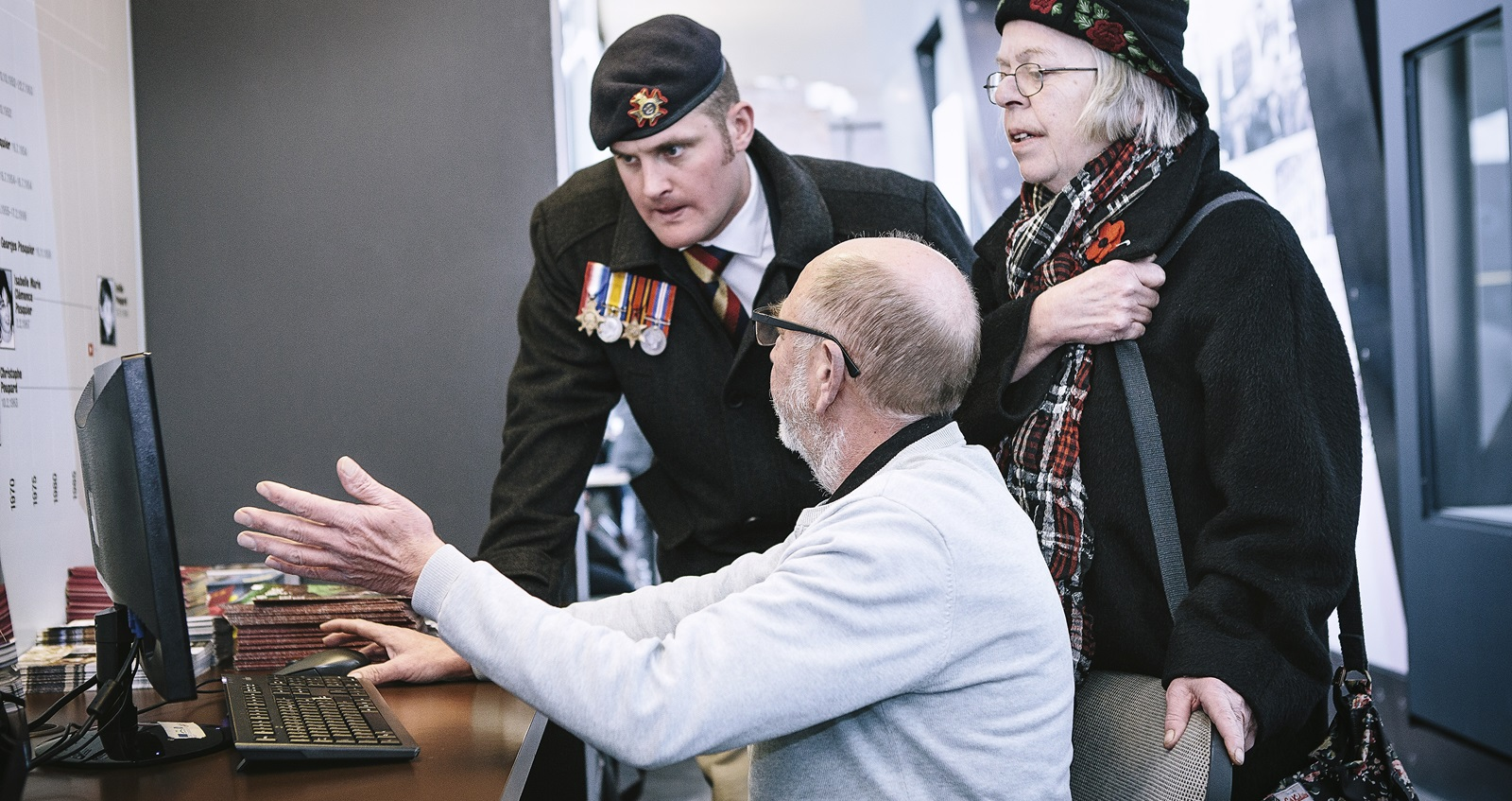 Veteran Liam Young speaking to a researcher on his computer on a trip to the battlefields of the First World War