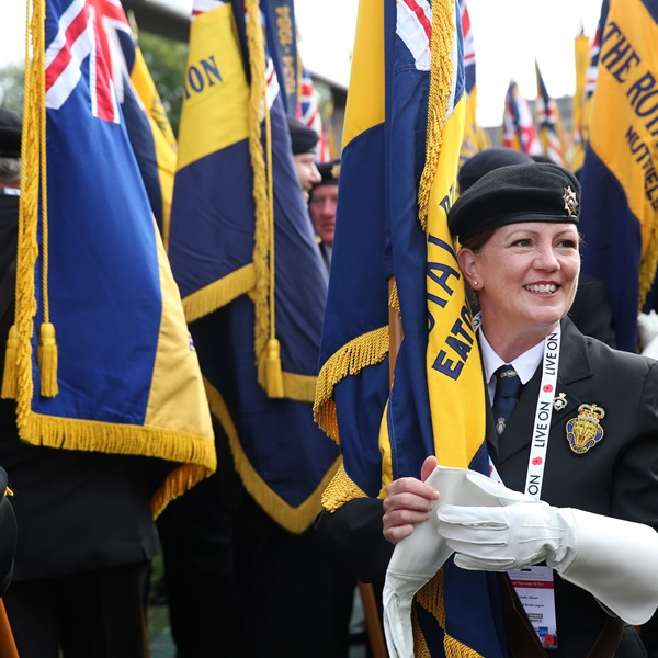 A Royal British Legion branch Standard Bearer preparing for a parade