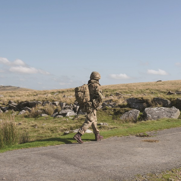 Soldier walking along roadside