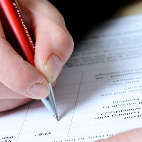 A person filling in a consultation form