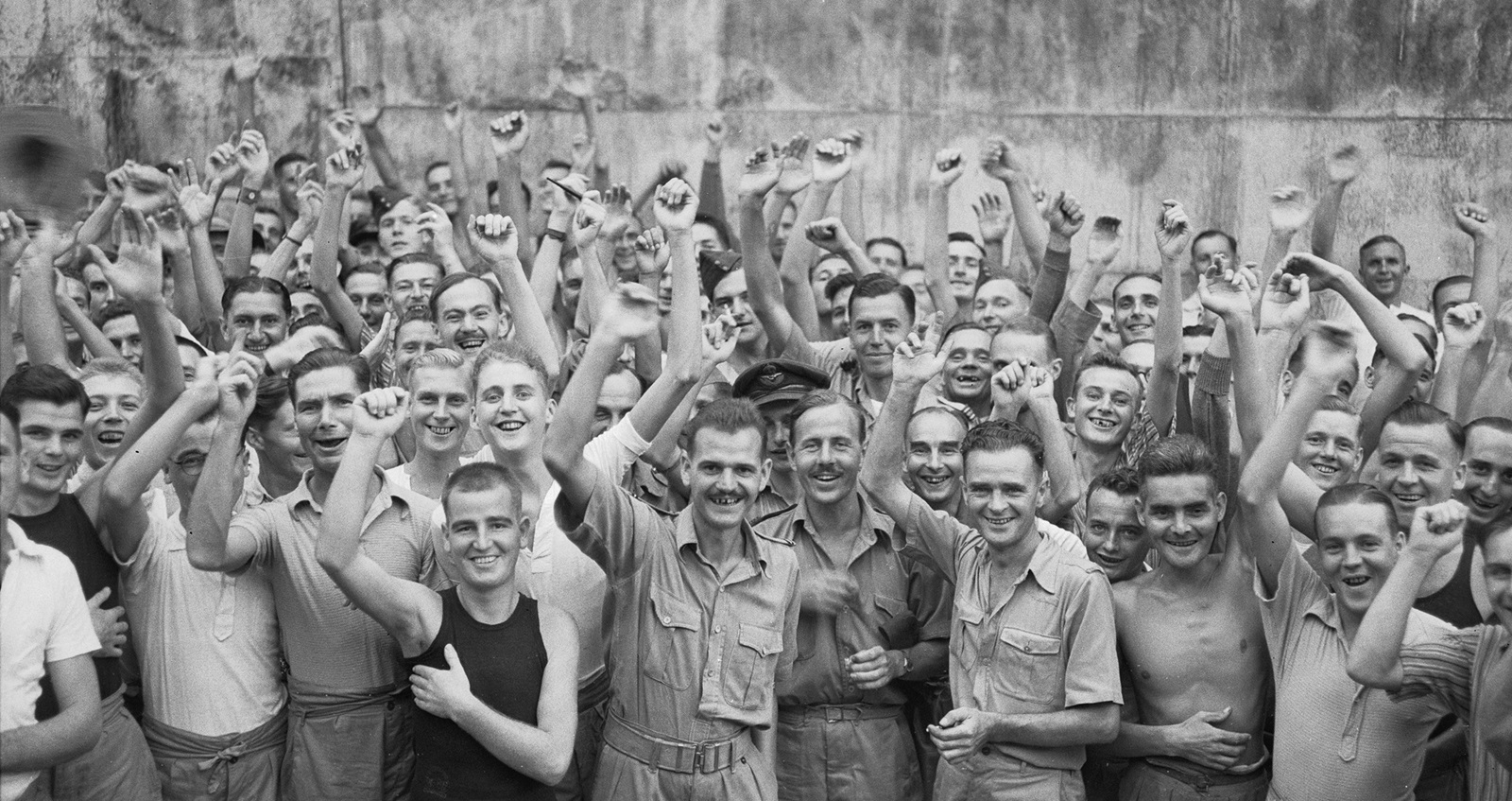 Allied prisoners of war celebrating their liberation from Changi Jail, Singapore © IWM (CF 712)