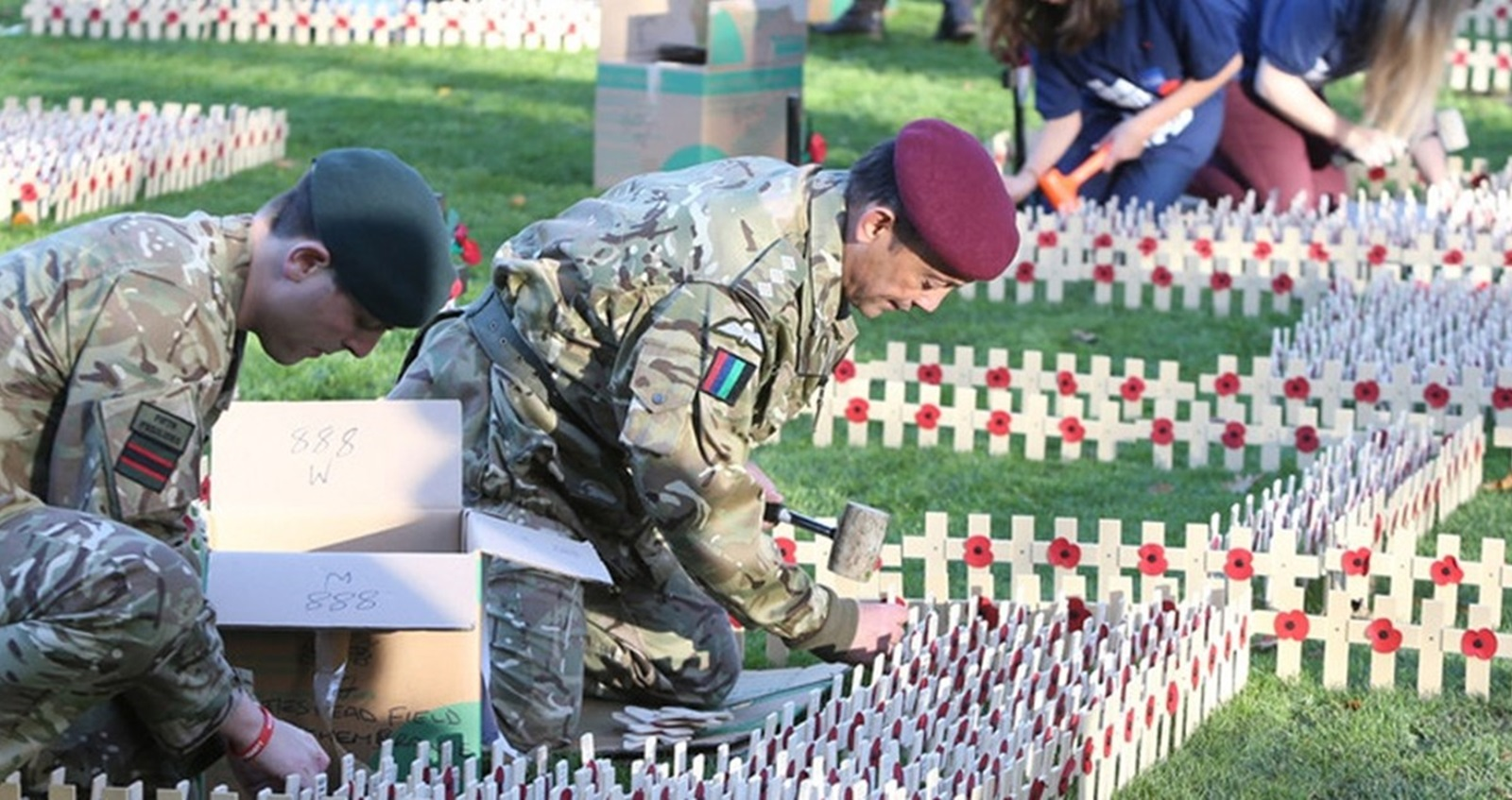 Volunteers from the Armed Forces creating Field of Remembrance