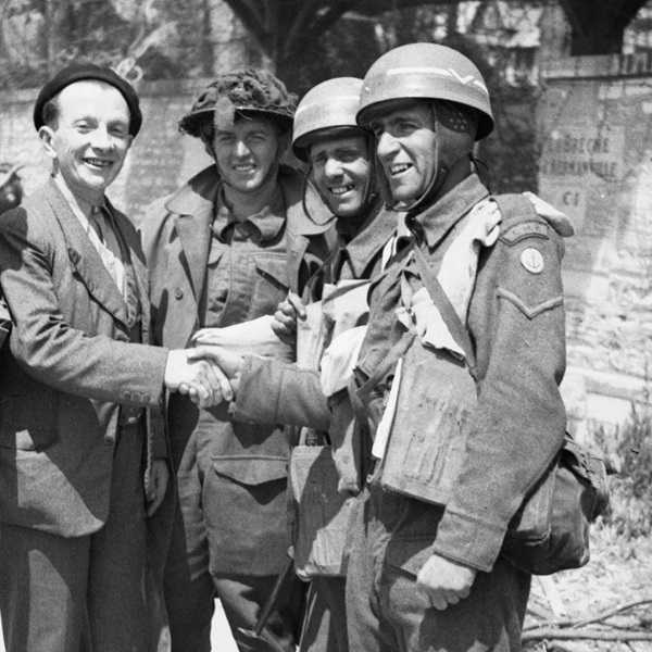French civilian greets British troops after D-Day