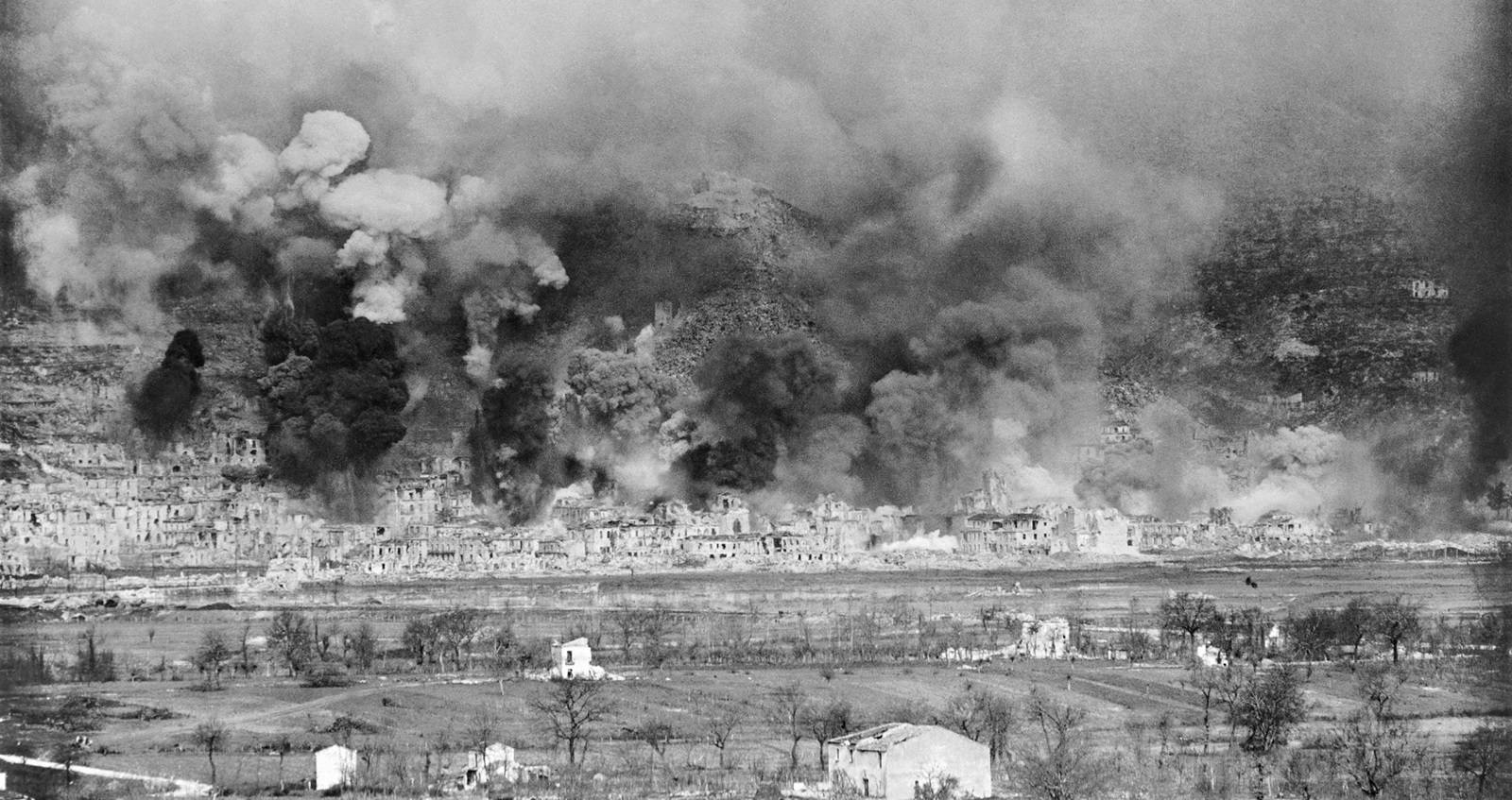 The town of Cassino shrouded in black smoke during the Allied barrage on 15 March 1944