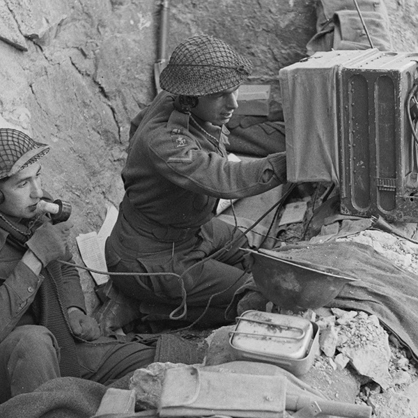 Troops sing a radio in a dugout on Monastery Hill.