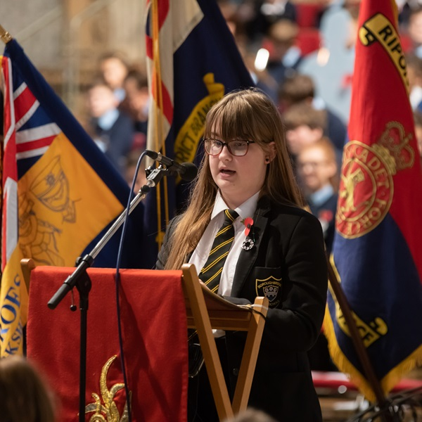 Young girl giving a speech at Ripon Cathedral for Remembrance 2018