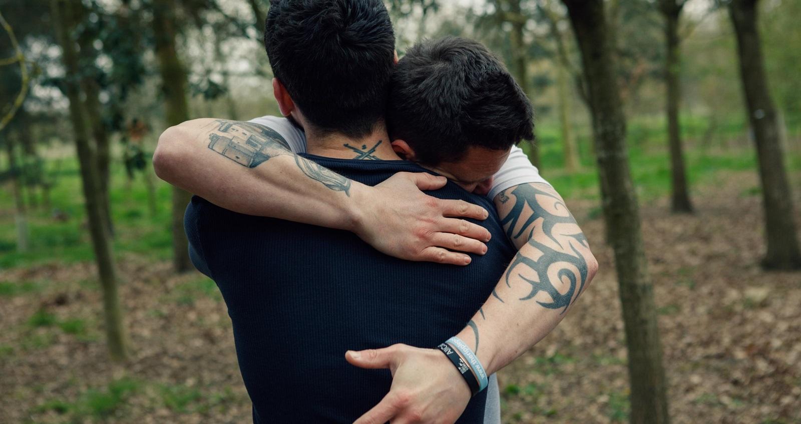 Dan Arnold and Stephen James hugging