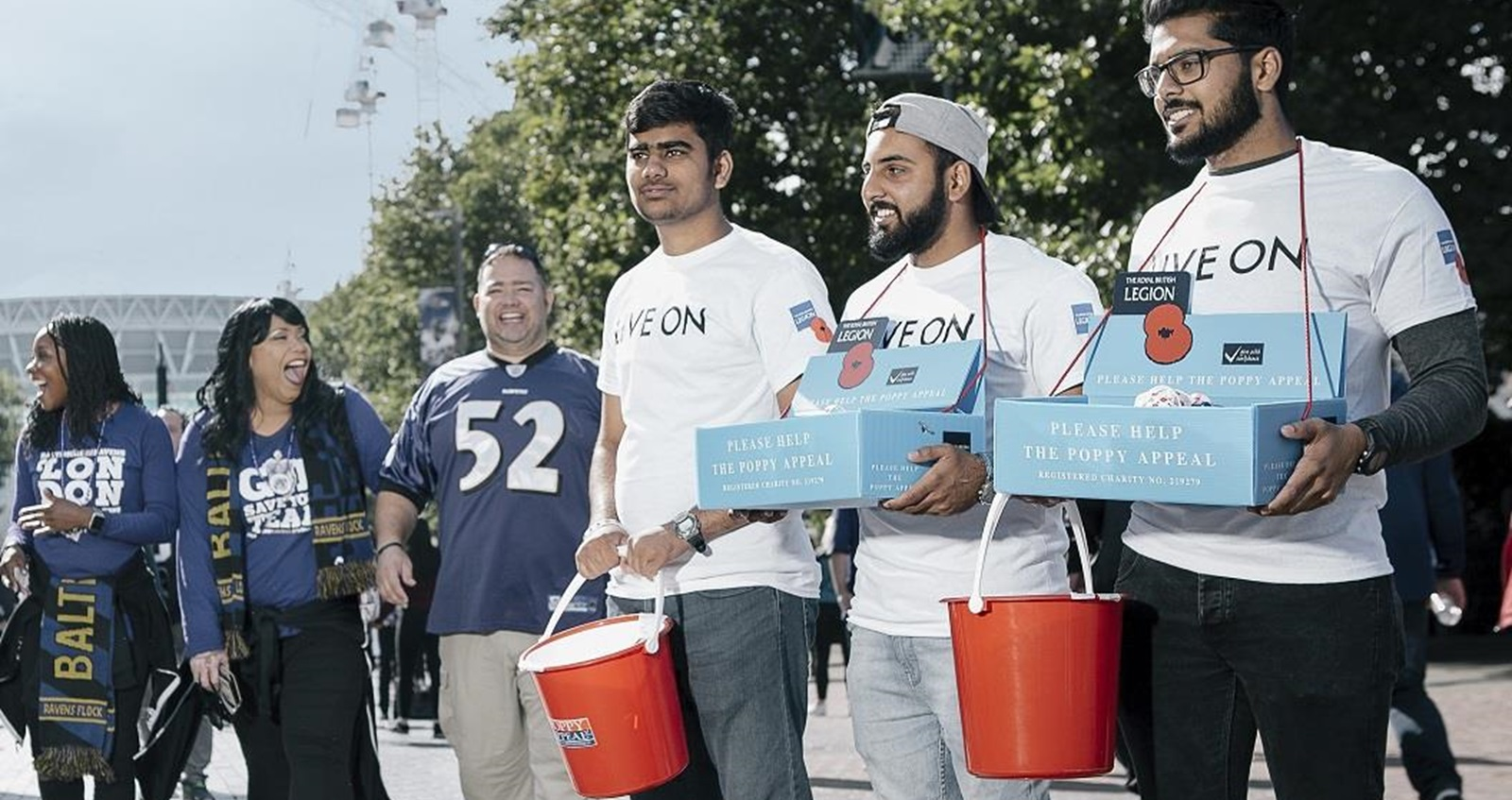 Volunteers from Ahmadiyya Muslim Youth Association distributing poppies during Poppy Appeal