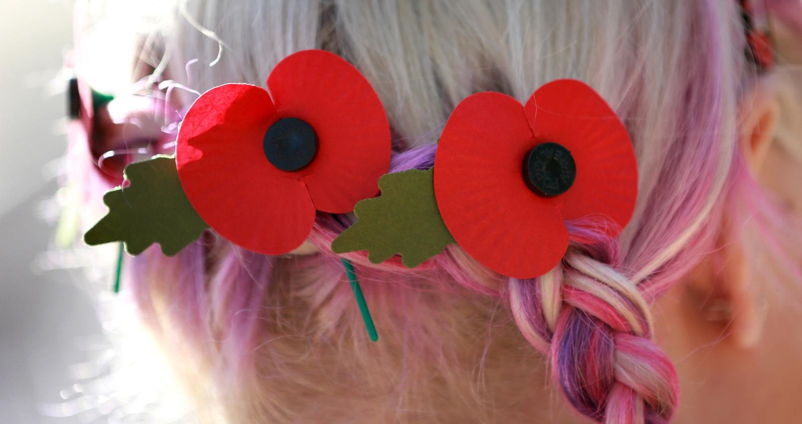 A volunteer wearing poppies in her hair