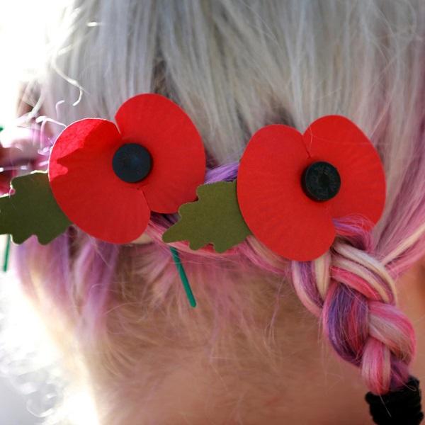 A volunteer wearing poppies in her hair