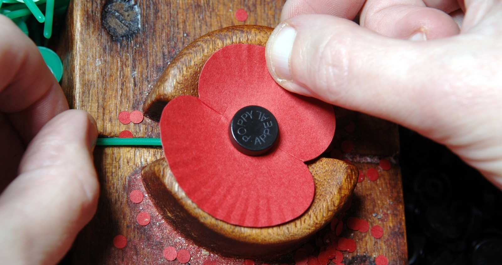 A paper poppy being made