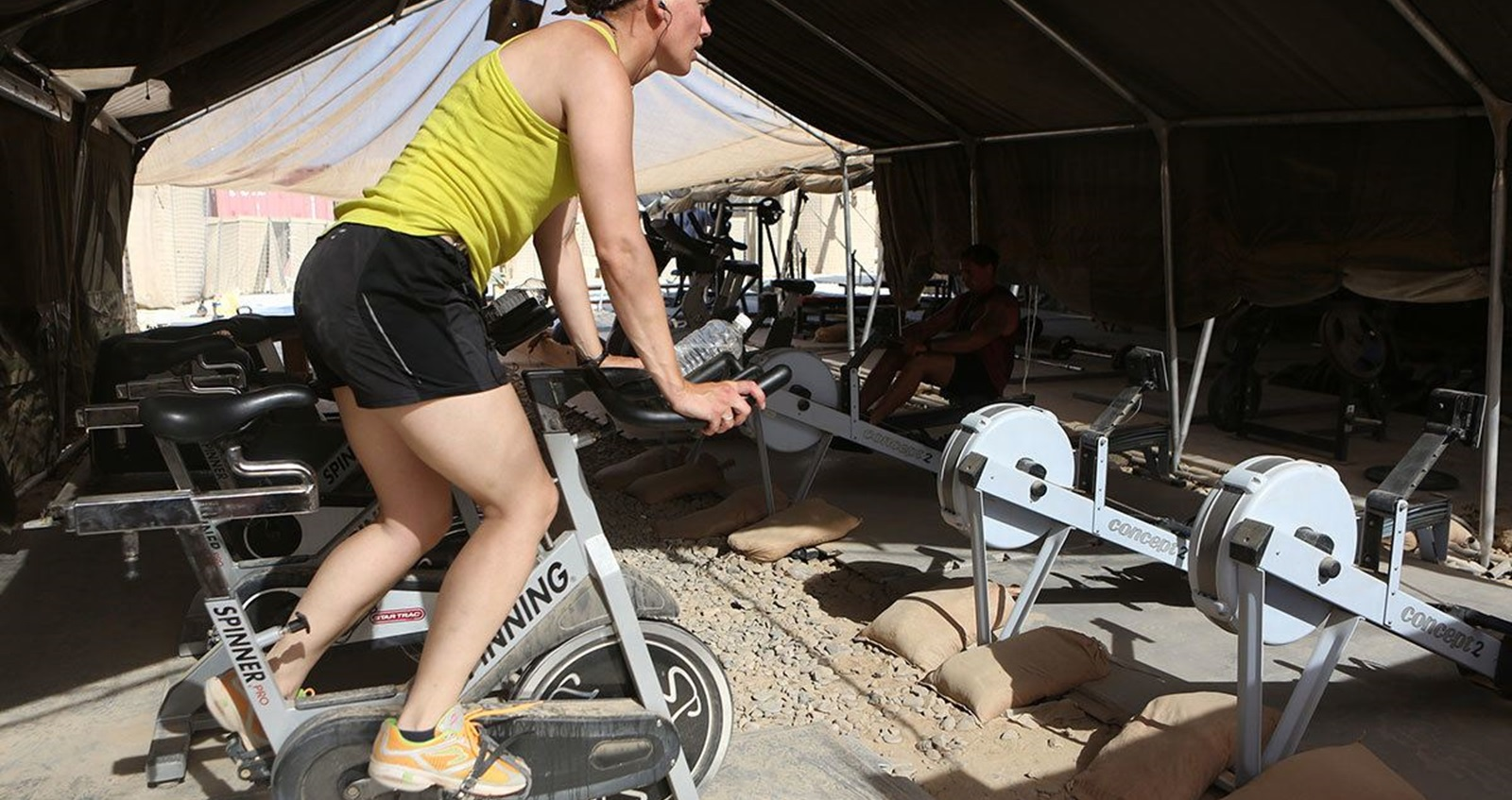 Anna Crossley working out in a basecamp gym in Afghanistan.