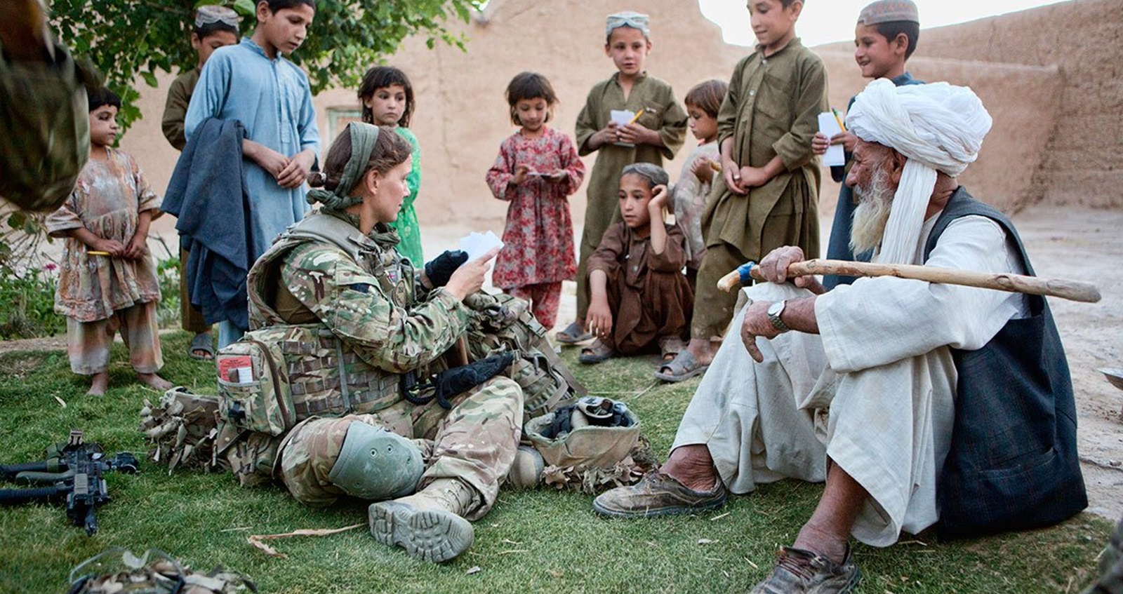 Anna Crossley in Afghanistan talking to Afghani children and elderly.
