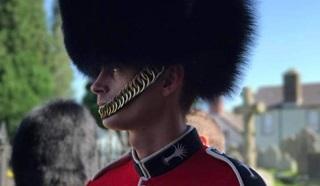 British Army soldier Adam, wearing a bearskin