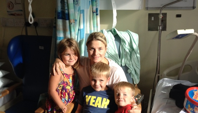 Anna in hospital with her children