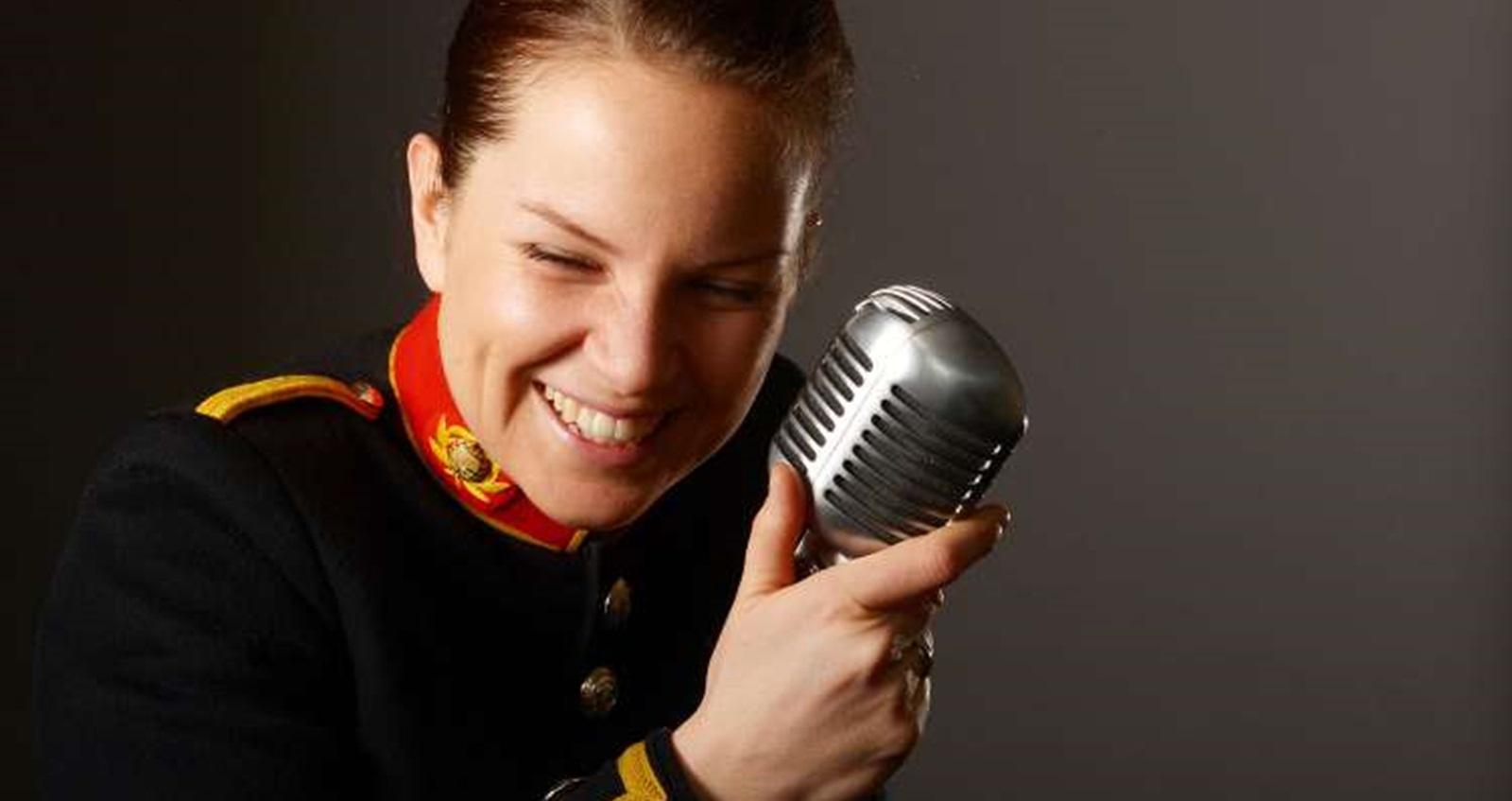 Poppy Pawsey in her band uniform singing