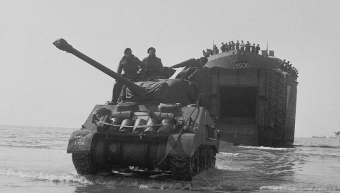 A Sherman Firefly tank comes ashore, 7 June 1944.