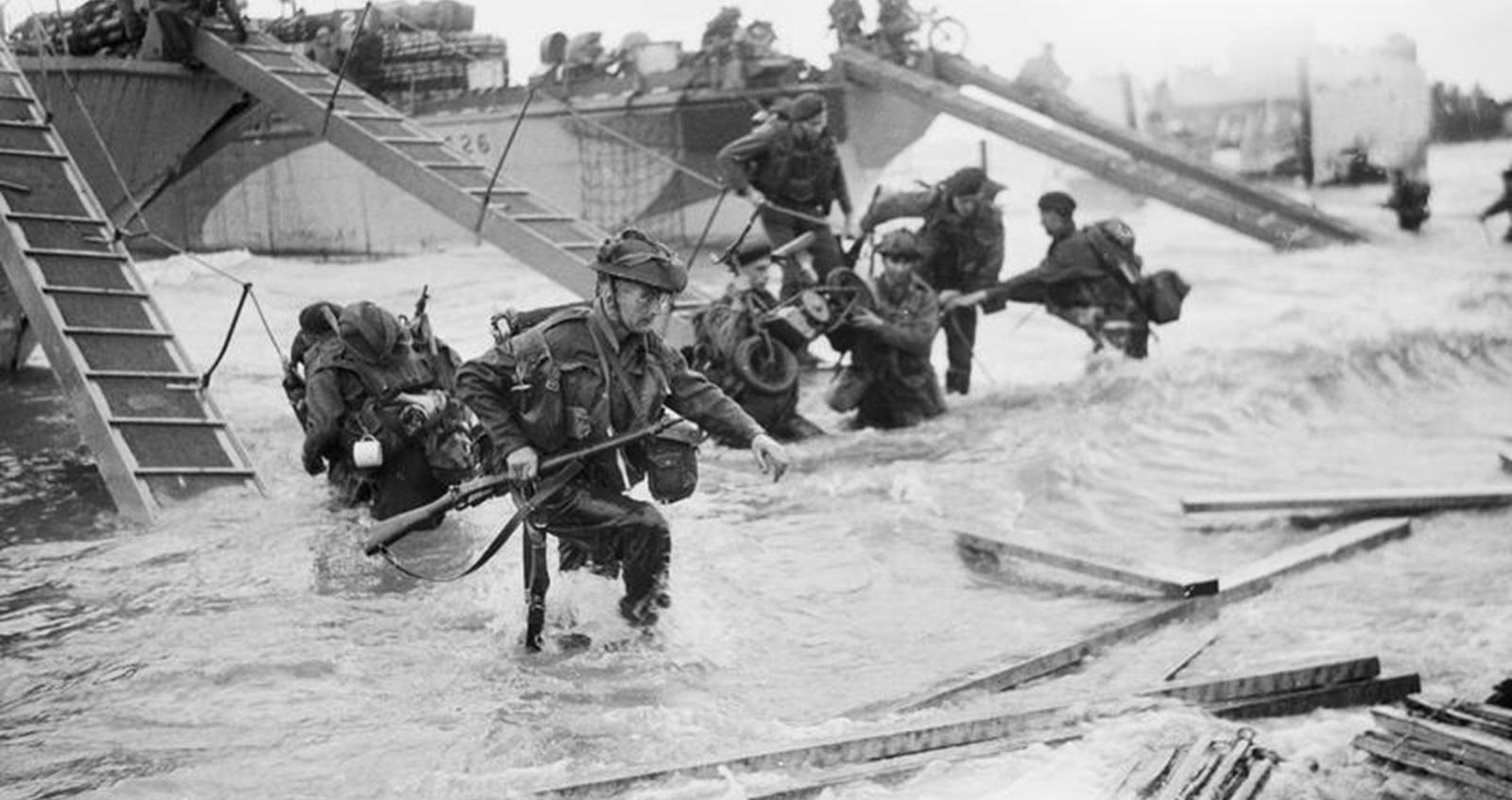 Royal Marine Commandos making their way onto the 'Nan Red' sector of Juno Beach, 6 June 1944.