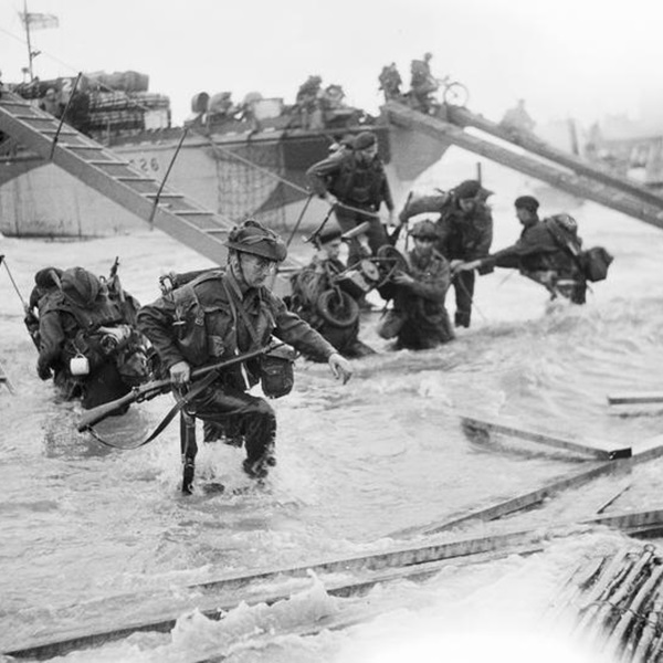 Royal Marine Commandos making their way onto the 'Nan Red' sector of Juno Beach, 6 June 1944.