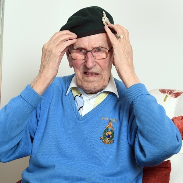 Denis Fawcett adjusts his beret
