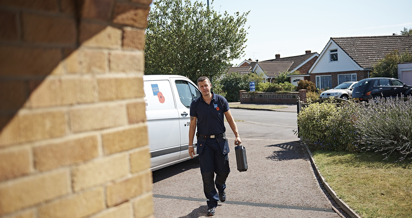 A member of Royal British Legion staff arriving to assess a veterans home