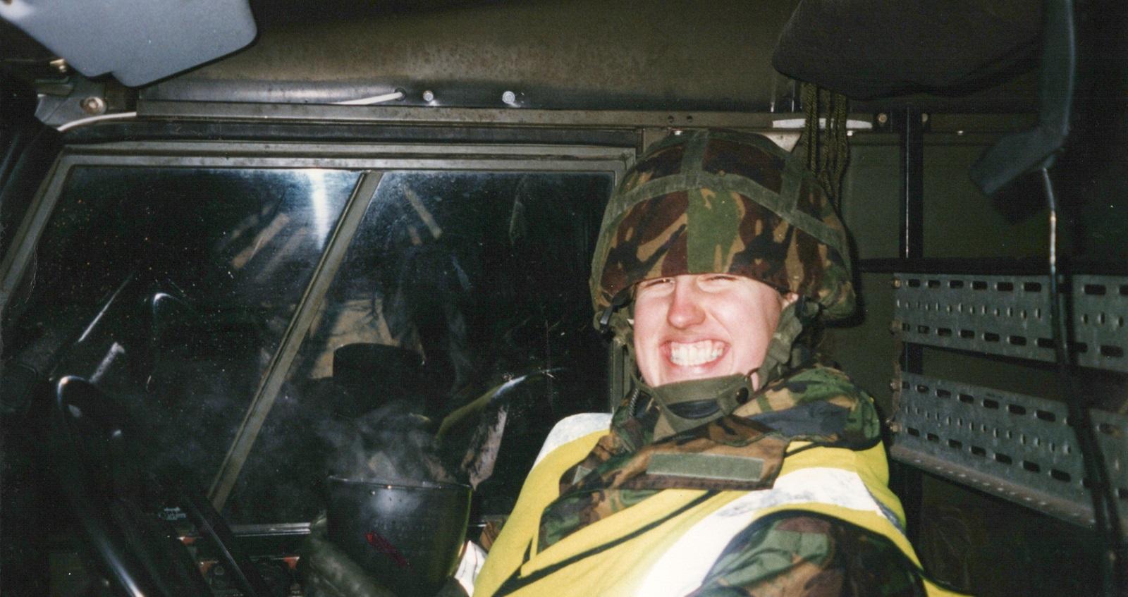 Kate Green smiling wearing camo uniform