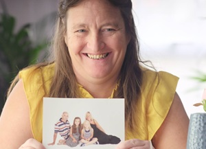 Chantele holding a picture of her family