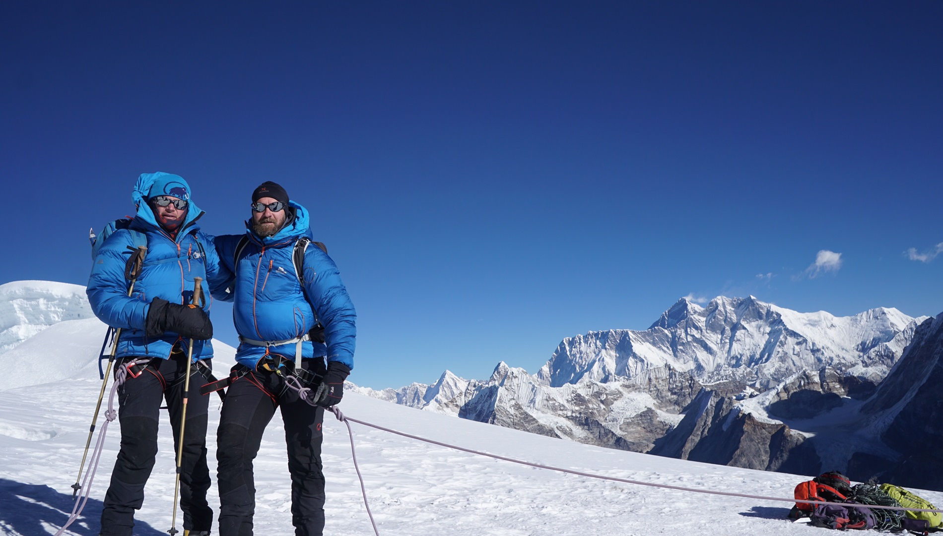 Members of the Mission Himalaya team pose with Mount Everest in the background